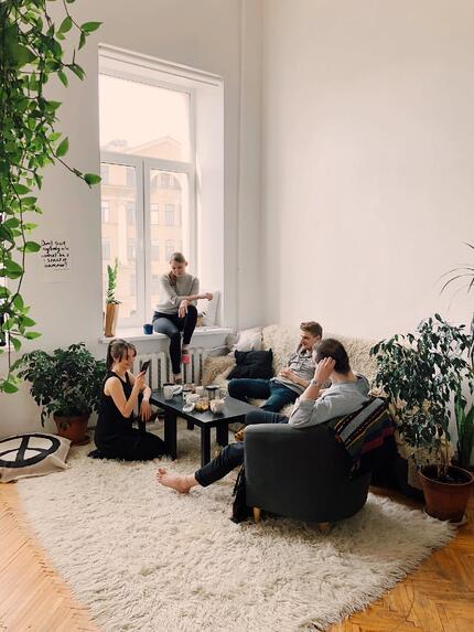 friends hanging out in living room
